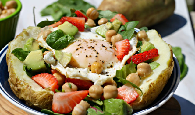 Baked Potato with fresh kale, strawberries, chickpeas and an egg